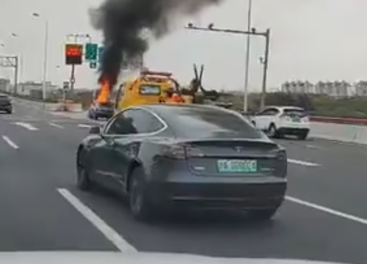Tesla causes car to catch fire as it drives by